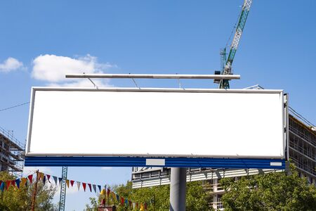 Photo for Huge blank white advertising billboard in front of apartment building under construction - Royalty Free Image