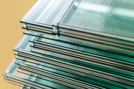 Photo pour Sheets of Factory manufacturing tempered float glass panels cut to size - image libre de droit