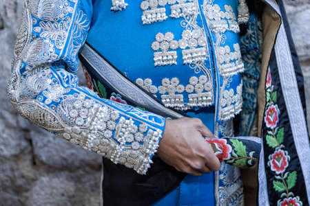 Ubeda, Jaen province, SPAIN - 29 september 2010  Spanish Bullfighter with blue dress and silver ornaments, the mantle is placed to start the paseíllo before beginning the bullfighting in Ubeda, Jaen provincia, Andalusia, Spain