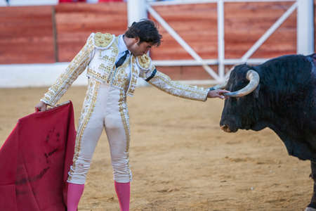 Jaen, SPAIN - September 9, 2011: The Spanish Bullfighter Curro Diaz greeting the public with its cap in the hand in gratitude to its bullfight in the Bullring of Jaen, Spain