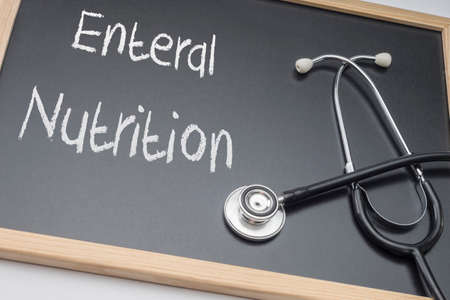 Foto de Enteral nutrition written on a blackboard, conceptual image, horizontal composition - Imagen libre de derechos