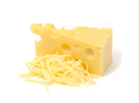 Chunk of Swiss Cheese And Pile of Grated Cheese Isolated on White Background
