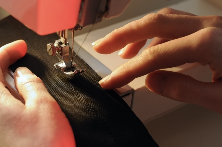 Tailor at Work on Sewing Machine
