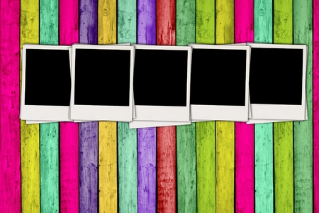 Five Blank Photos on Colorful Wood Background