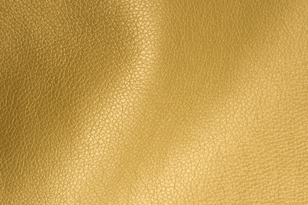 Foto de Golden Glossy Artificial Leather Background Texture Close-Up - Imagen libre de derechos