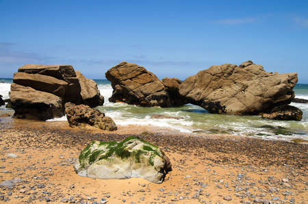 Large rocks at the wild deserted beach of Malhada do Cedouro near Cabo da Roca  Sintra, Portugal