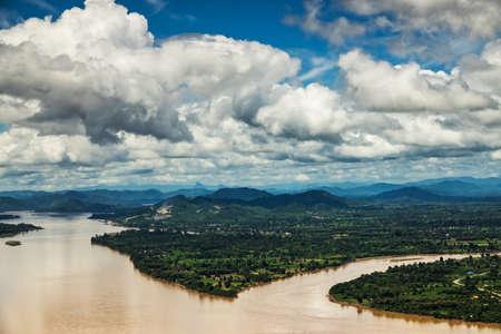 Foto de Mekong River At Nong Khai In Thailand, high angle view of landscape with cumulus clouds - Imagen libre de derechos