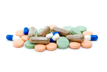 Pile of various pills and tablets isolated on the white background