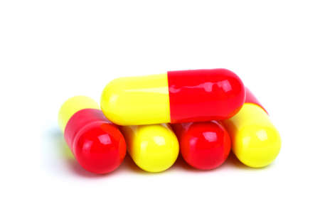Some yellow-red capsules isolated on the white background