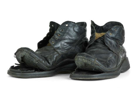 Pair of old boots  isolated on the white background