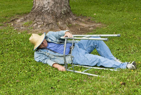elderly man with a walker falls in the park