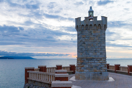 Photo for The Rocchetta Lighthause in Bovio square, Piombino, Italy, at sunset - Royalty Free Image