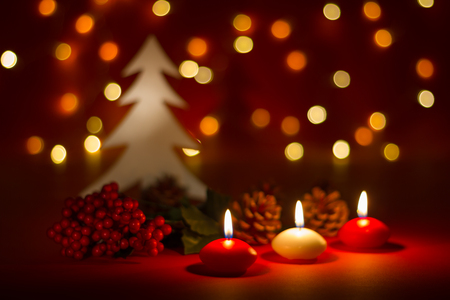 Photo for Christmas candles and ornaments over red dark background with lights - Royalty Free Image