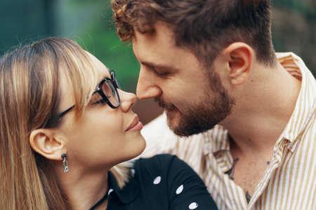 Photo pour Closeup portrait of a loving couple in the backyard of their own home - image libre de droit