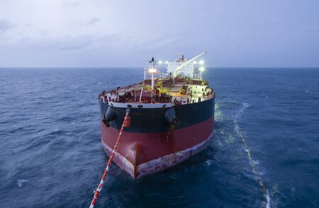 Photo for Oil tanker is transferring supply to the oil vessel. - Royalty Free Image