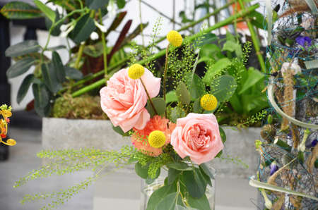 Foto für Floral shop concept Florist creates flower in a wicker basket. Beautiful bouquet mixed flowers. fresh bunch. Flowers delivery. Colorful bouquet of different orchids, roses, freesia eucalyptus leaves - Lizenzfreies Bild