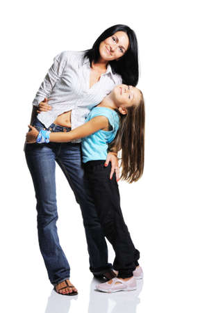 Photo for Mother with daughter isolated on white background. Studio shot with mirroring - Royalty Free Image