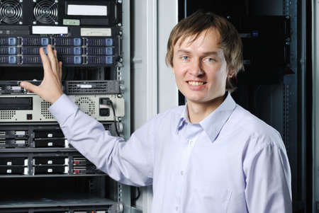 Portrait of young datacenter specialist in fron of equipment
