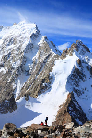 Two climbers against the backdrop of the mountains Dykh-tau