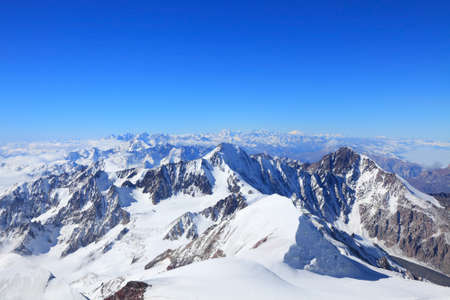 view of all highest tops of main caucasus ridge between Kazbek and Elbrus.