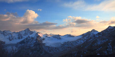 sunset in the caucasus ridge. View from the slope of the elbrus