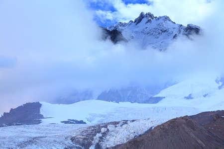 rocky peak towering over the glacier