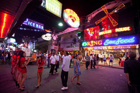 PATTAYA, THAILAND - FEBRUARY 20: Nightlife on Walking Street on February 20, 2012 in Pattaya, Thailand. It is a tourist attraction that draws foreigners and Thai nationals, primarily for the sex services and entertainment.
