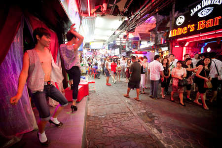 PATTAYA, THAILAND - FEBRUARY 20: Nightlife near Gay bar on Walking Street on February 20, 2012 in Pattaya, Thailand. It is a tourist attraction that draws foreigners and Thai nationals, primarily for the sex services and entertainment.