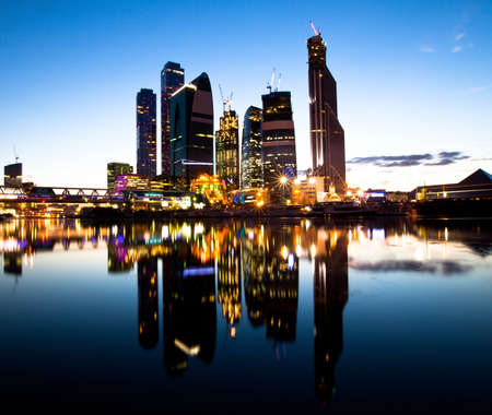 New skyscrapers Moscow business centre  Moscow City  at evening with water reflections