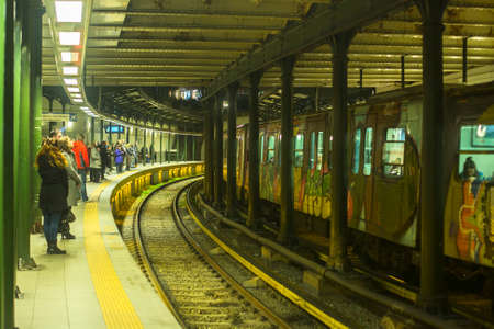 ATHENS, GREECE - MAR 23, 2015: Urban metro station with departing train. The Athens Metro is a rapid-transit system opened as a conventional steam railway in 1869, and which was electrified in 1904.