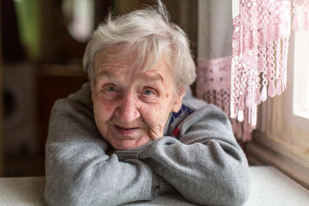 Photo for Portrait of an elderly woman, close-up, sitting at the table. - Royalty Free Image