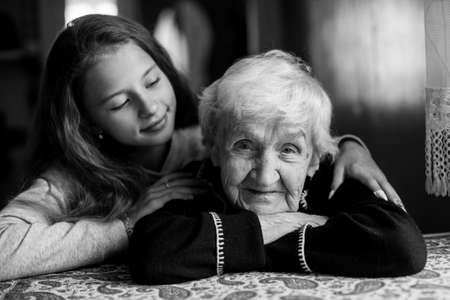 Photo pour Happy granny and little girl. Black and white photo. - image libre de droit