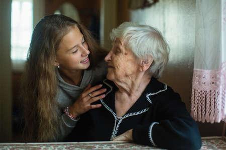 Photo pour Portrait of cute little girl with old lady grandmother. - image libre de droit
