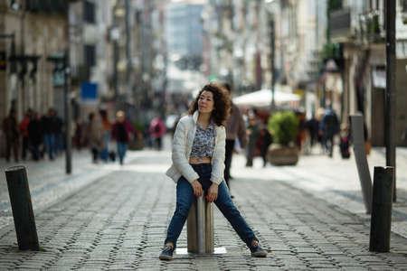 Photo pour Young asian mixed-race woman is posing on the St. Catarina street, Porto, Portugal. - image libre de droit