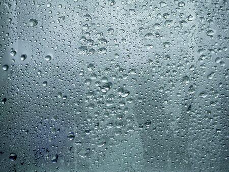 Photo pour Frozen Water Drops On Window. Texture of glass with frozen drops of water. texture of frozen water drops ice glass. Image For desktop, wallpapers, banner. Copy space, text box. - image libre de droit
