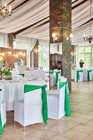 Wedding ceremony. Decor wedding celebration. Decoration of chairs.