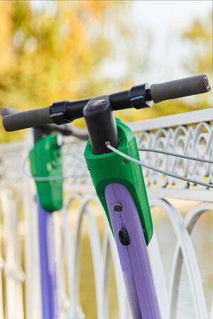 Foto de Electric scooters for rent on the city streets. Scooter rental in the park - Imagen libre de derechos