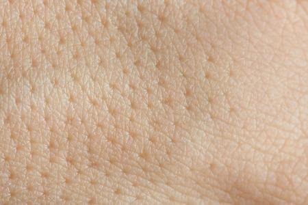 Photo pour Pores on human skin macro. Close up of caucasian skin with holls - image libre de droit