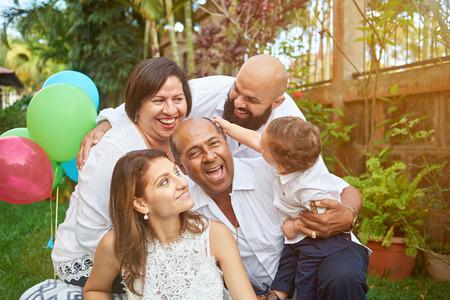 Photo pour Latino family have fun on garden with small son kid boy - image libre de droit