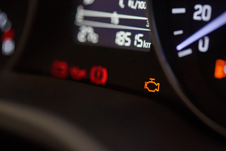 Check ingine icon on modern car dashboard close-up