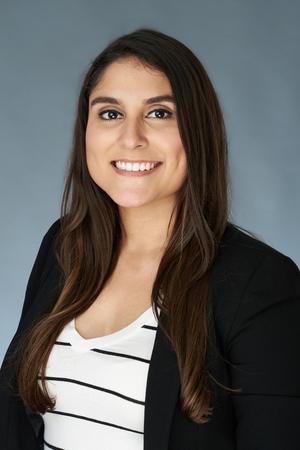 Photo pour Hispanic young woman portrait in black jacket on studio background - image libre de droit