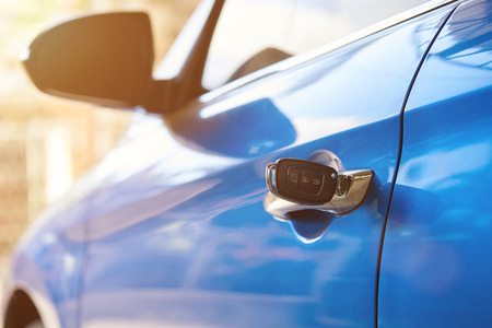 Photo for Silver vehicle handle with key close-up on sunny day background - Royalty Free Image