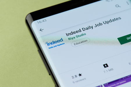 Photo for New york, USA - april 22, 2019: Installing indeed daily job tool to smartphone app from google market - Royalty Free Image
