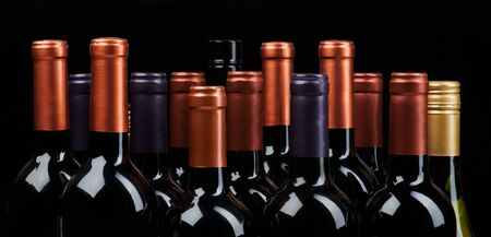 Photo for Many wine bottles heads isoalted on black background - Royalty Free Image