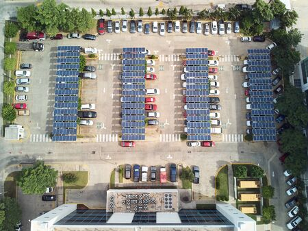 Photo for Parking lot with solar panels for charging cars above top view - Royalty Free Image