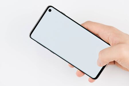 Foto de Using smartphone with one hand isolated on white background - Imagen libre de derechos
