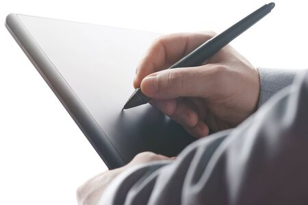 Photo pour Putting electronical signature with tablet close up view - image libre de droit