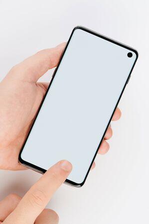 Foto de Touching screen on modern smartphone isolated on white background - Imagen libre de derechos