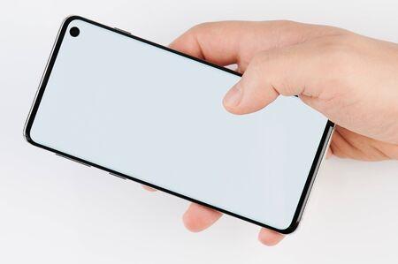 Foto de Empty smartphone display in hand close up view isolated - Imagen libre de derechos