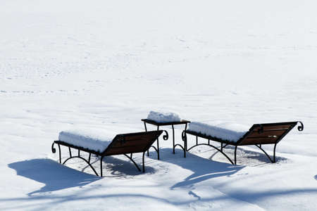 sun beds in the snow, sunbathing in the winter